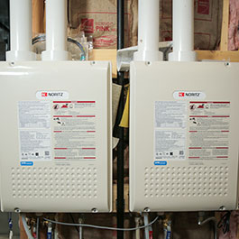 Two tankless propane water heaters